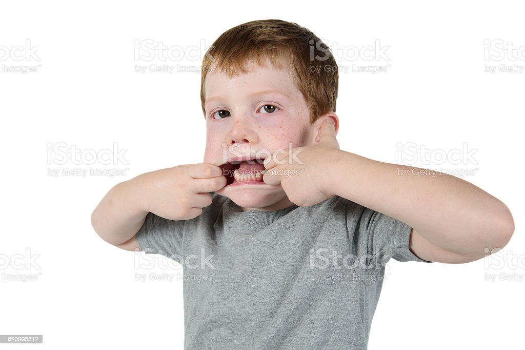 Little Boy Making Faces stock photo