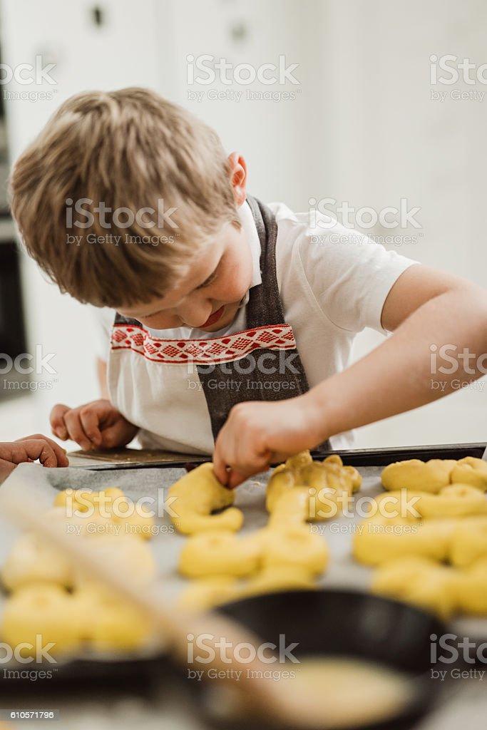 Little boy making saffron buns  for christmas stock photo