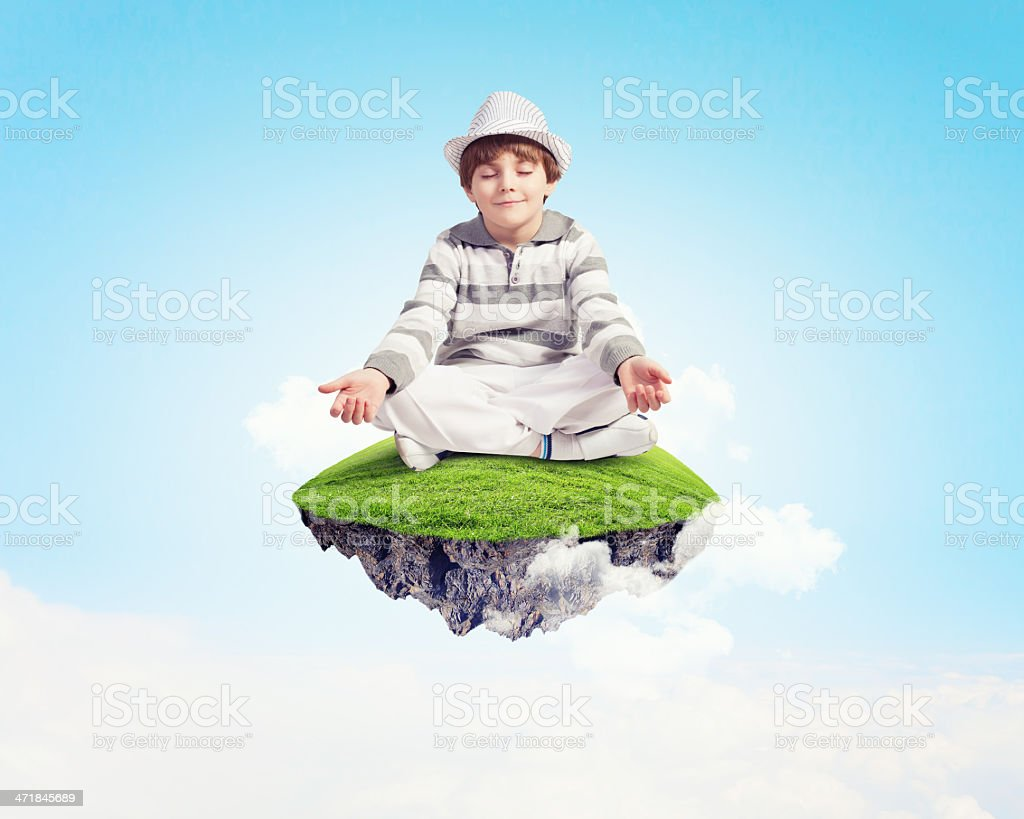 Little boy meditating royalty-free stock photo