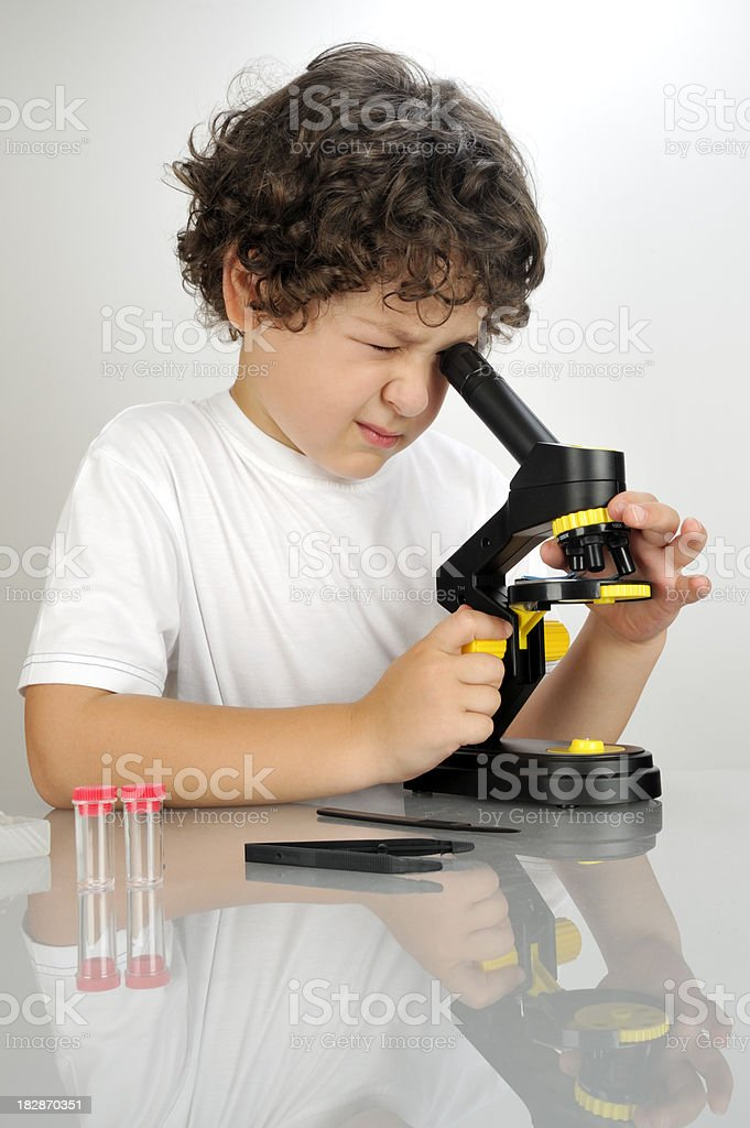 Little boy microbiologist royalty-free stock photo