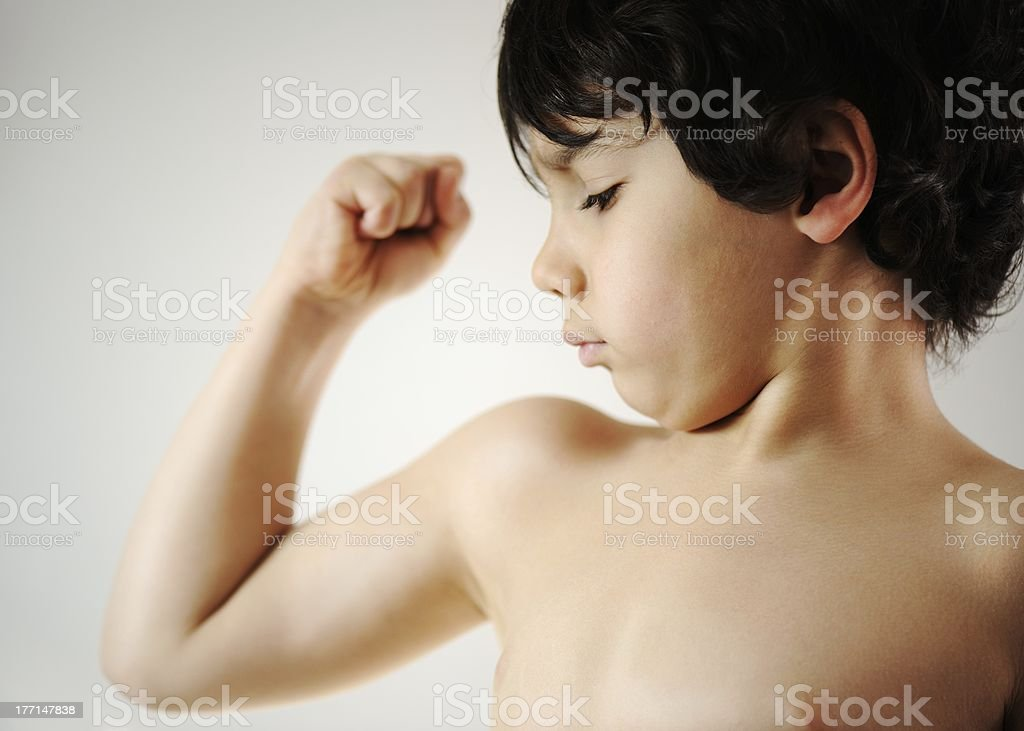 Little boy muscle royalty-free stock photo