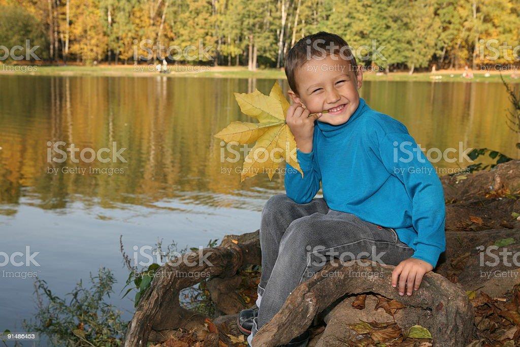 little boy near lake by autumn royalty-free stock photo