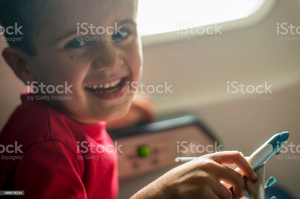 Little Boy on an Airplane stock photo
