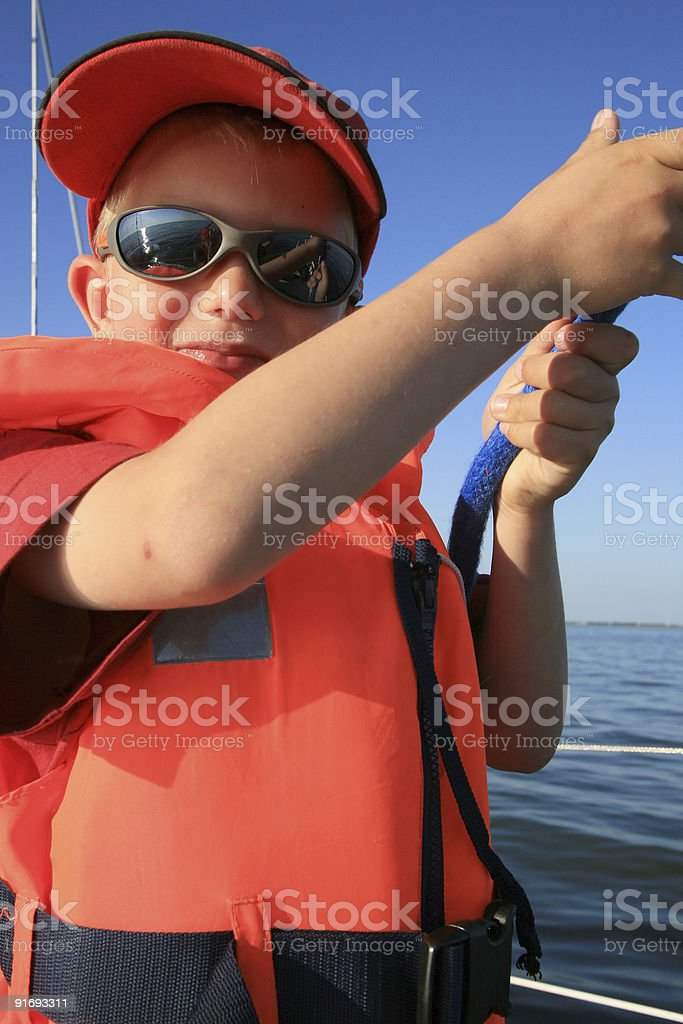 Little boy on sailboat royalty-free stock photo