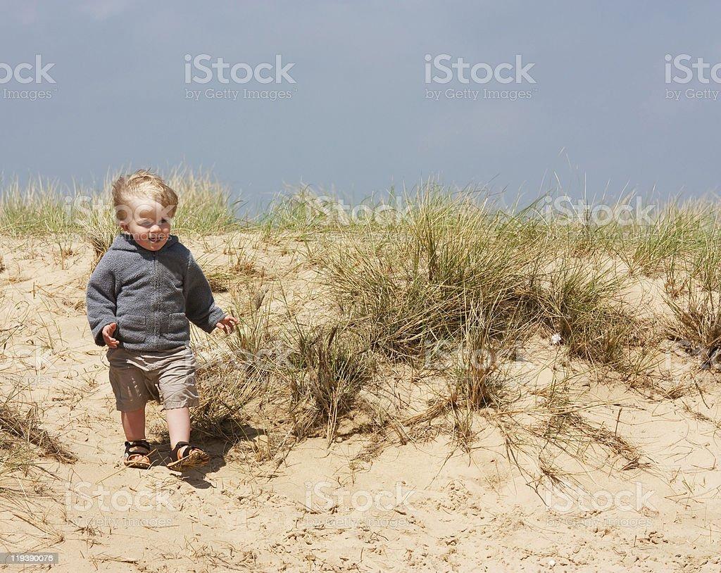 little boy on sand dunes stock photo