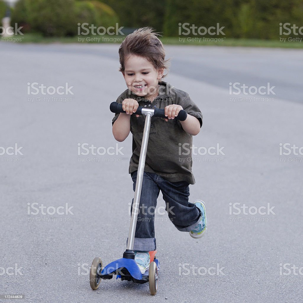 Little boy on scooter royalty-free stock photo