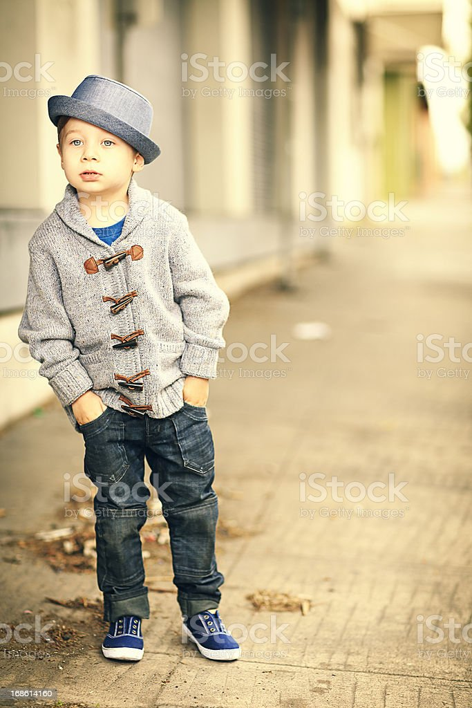 Little Boy on Sidewalk royalty-free stock photo
