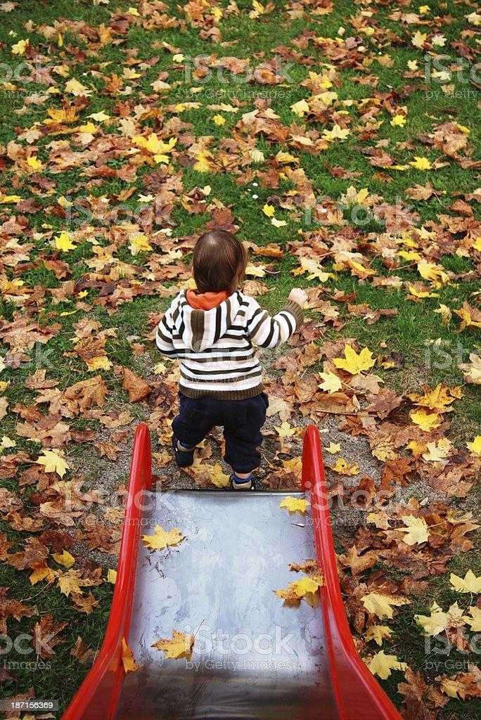 little boy on the playground stock photo