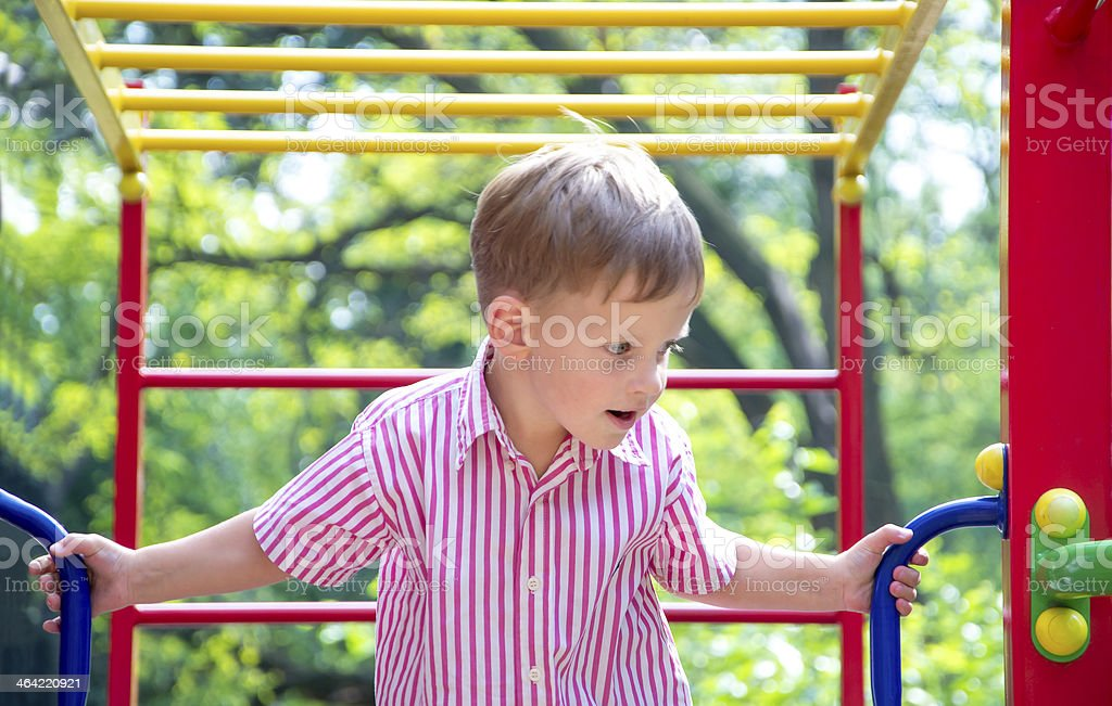 Little boy on the playground stock photo