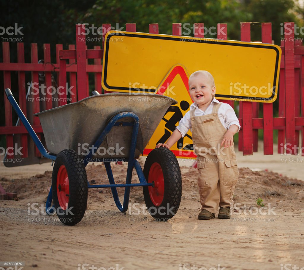 little boy on the repaired road stock photo