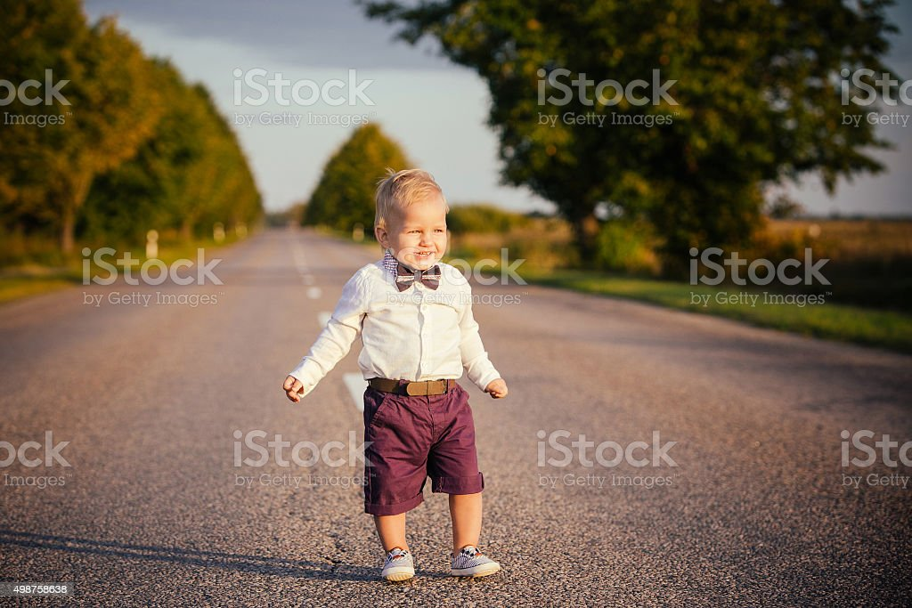 Little boy on the road stock photo