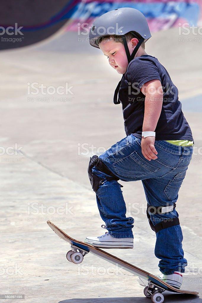 Little boy on the skateboard stock photo