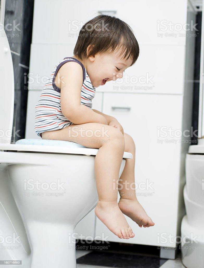 Little boy on toilet stock photo