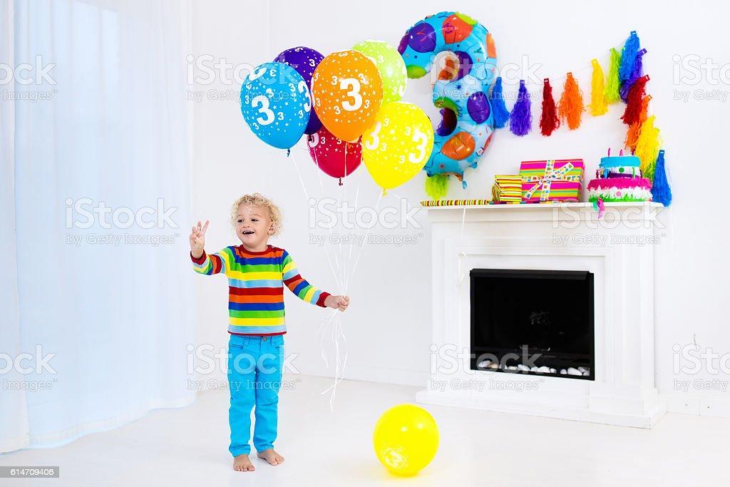 Little boy opening birthday presents stock photo