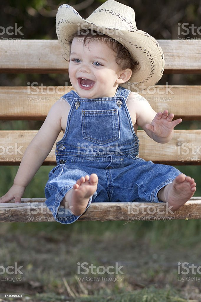 Little Boy Outdoors in Blue Denim Overalls royalty-free stock photo