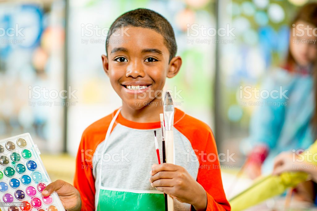 Little Boy Painting stock photo