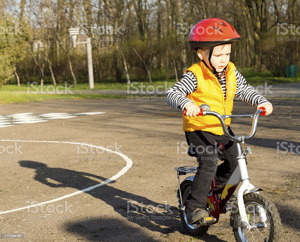 Little boy pedalling his bike royalty-free stock photo