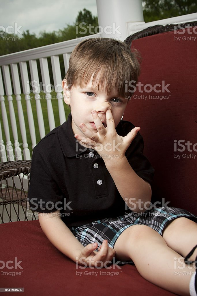 Little Boy Picking His Nose stock photo