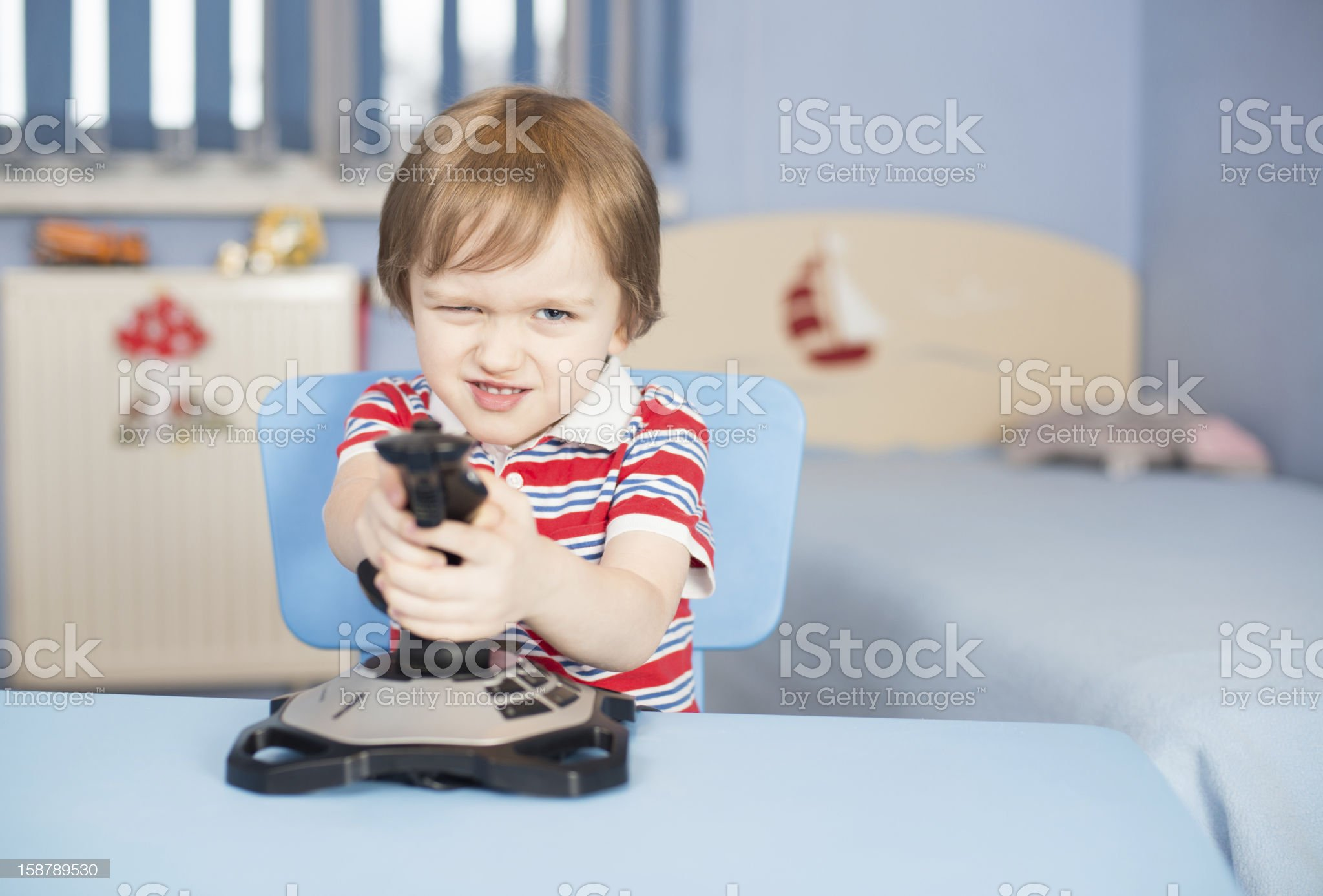 Little boy play computer games with joystick royalty-free stock photo