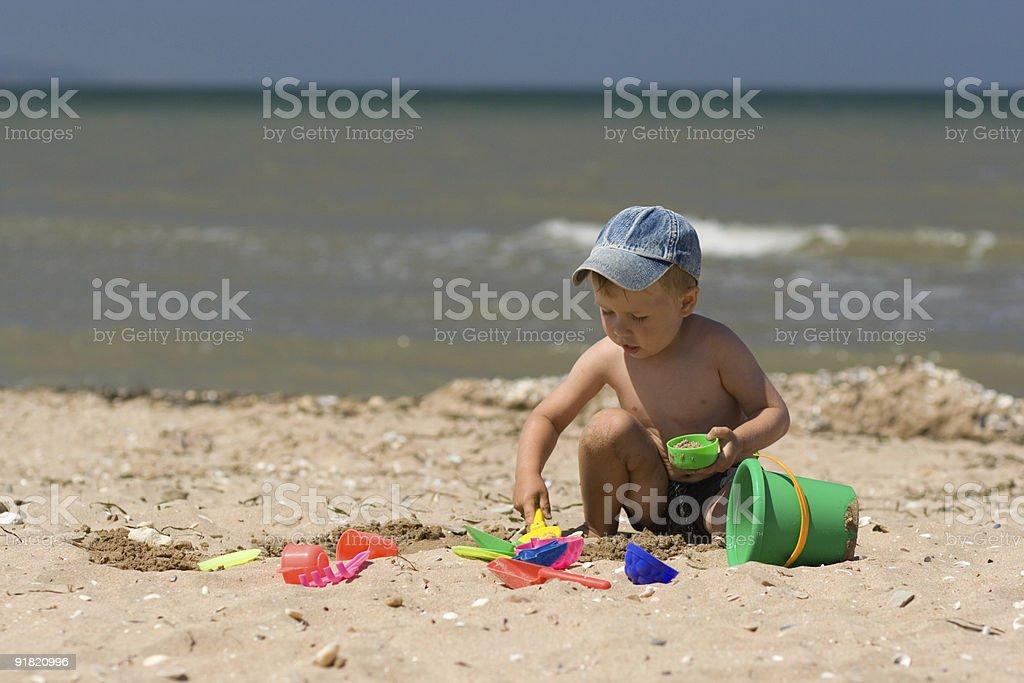 Little boy play on beach royalty-free stock photo