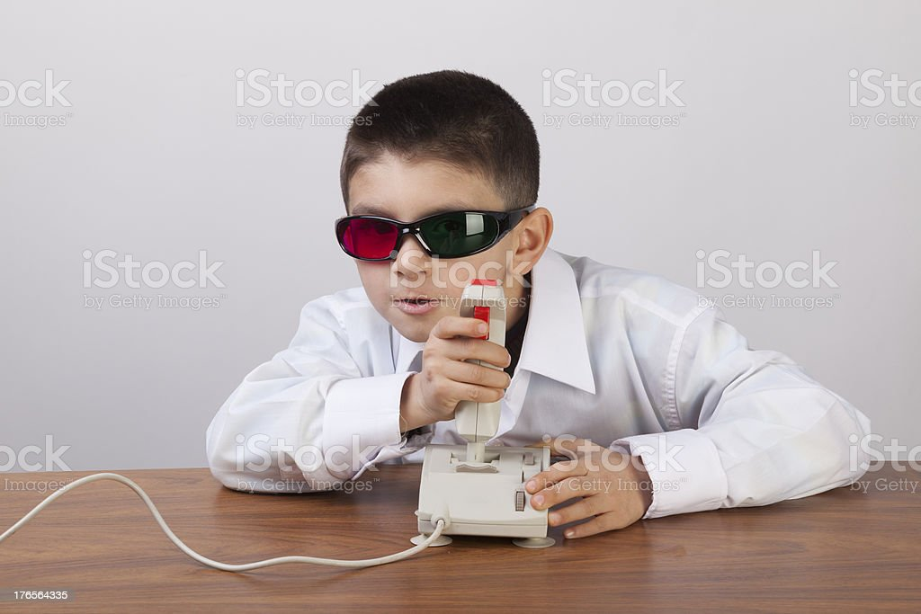 Little boy playing 3d video game royalty-free stock photo