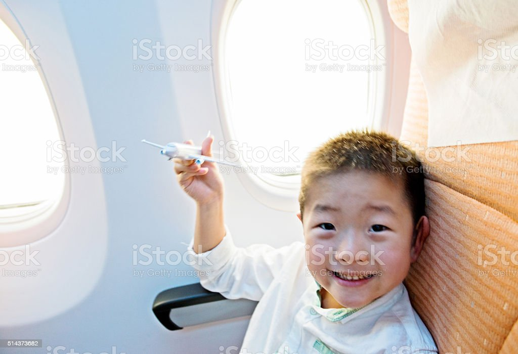 Little boy playing a toy plane stock photo