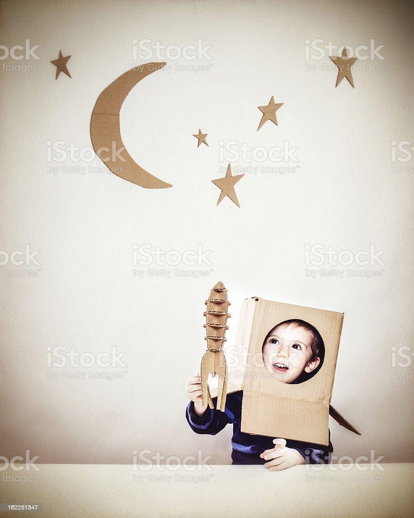 Little boy playing astronauts royalty-free stock photo