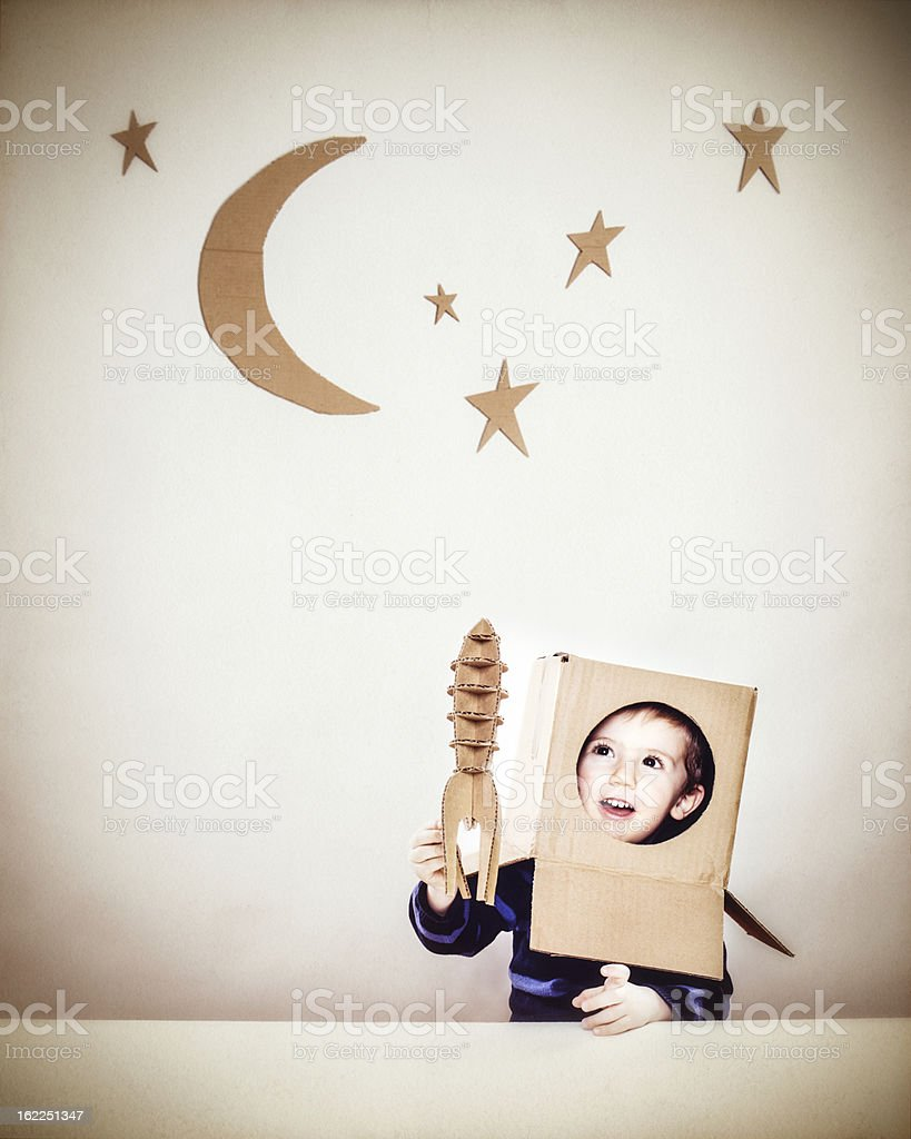 Little boy playing astronauts stock photo