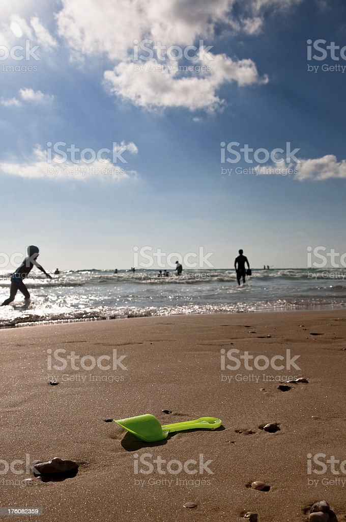 Little Boy playing at the Beach stock photo
