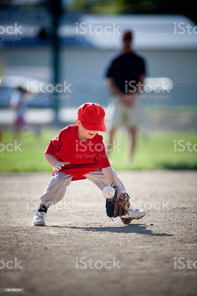Little Boy Playing Baseball stock photo
