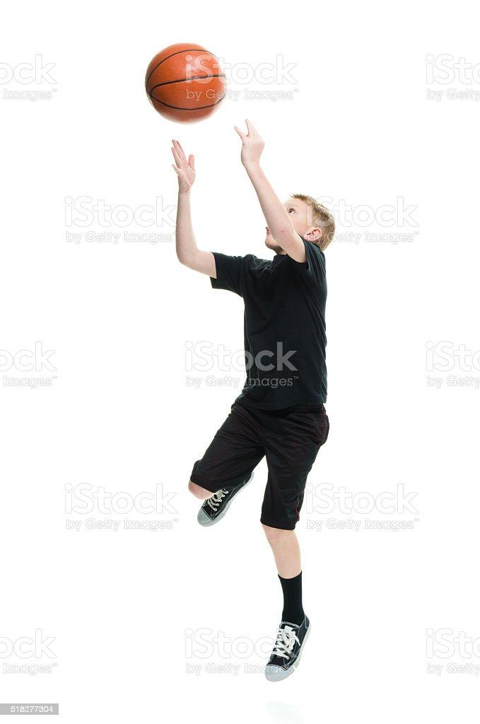Little boy playing basketball stock photo