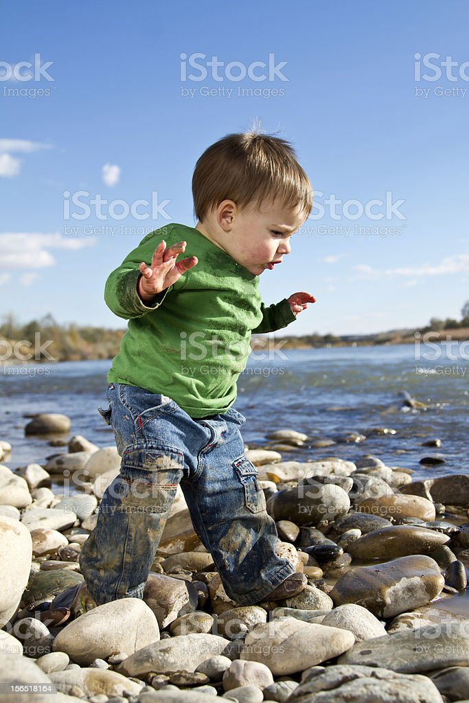 Little Boy Playing by Water royalty-free stock photo