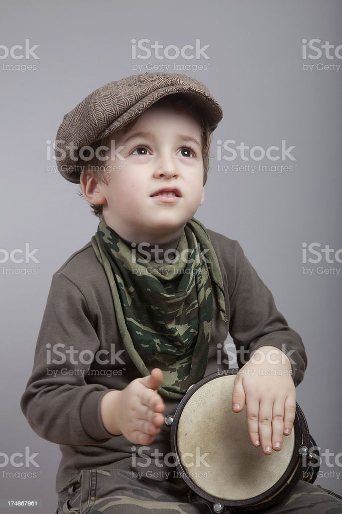 Little boy playing drum stock photo