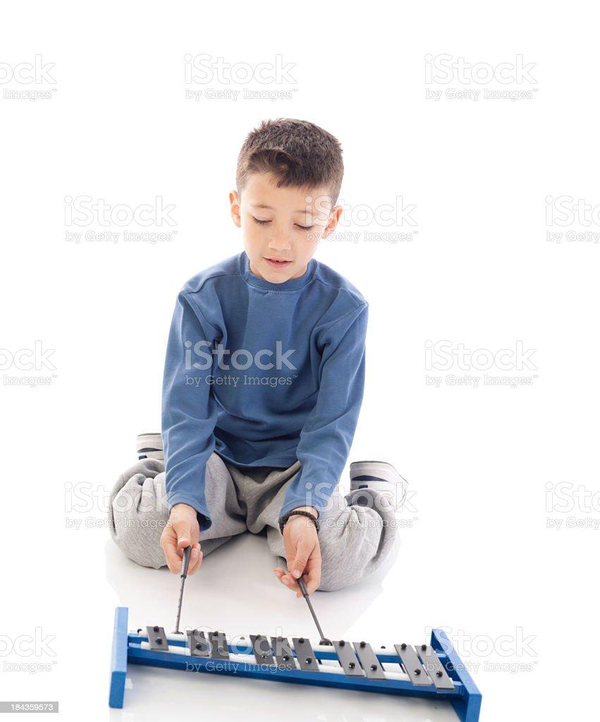 Little boy playing glockenspiel. stock photo