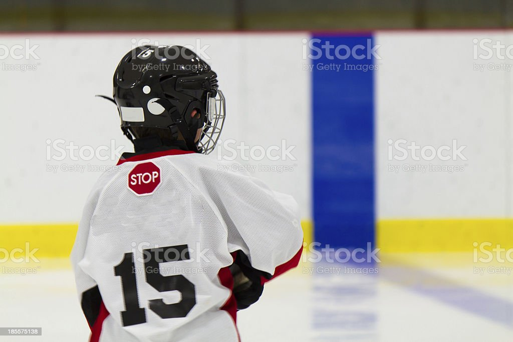 Little boy playing ice hockey royalty-free stock photo