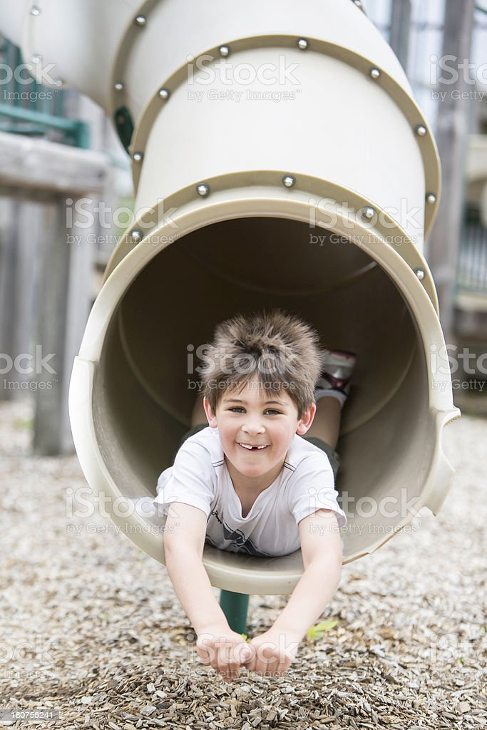 Little boy playing in playground royalty-free stock photo