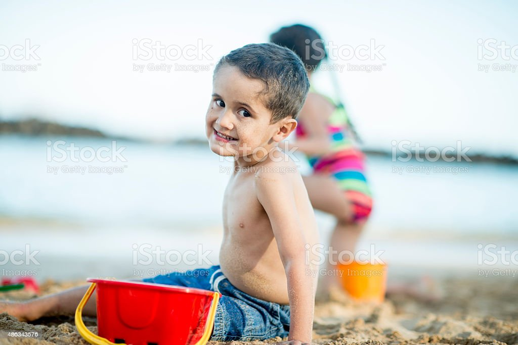 Little Boy Playing in the Sand stock photo