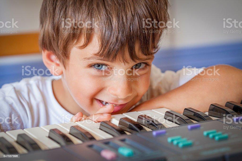 Little Boy Playing Keyboard stock photo