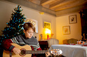Little Boy Playing on Guitar on Christmas