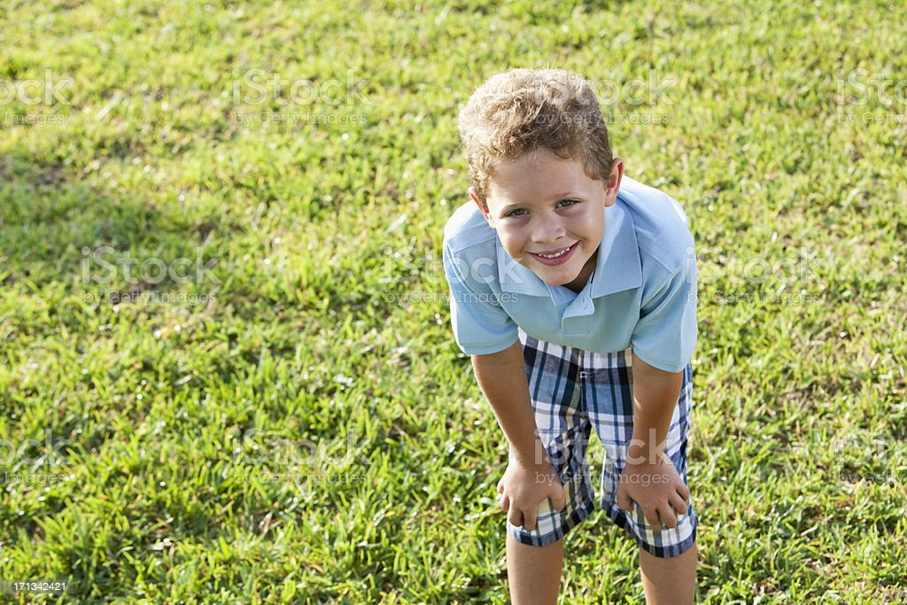 Little boy playing outdoors royalty-free stock photo