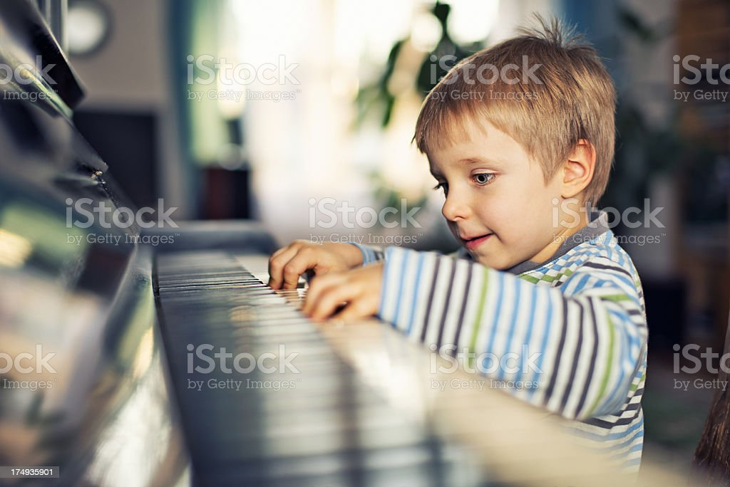 Little boy playing piano royalty-free stock photo