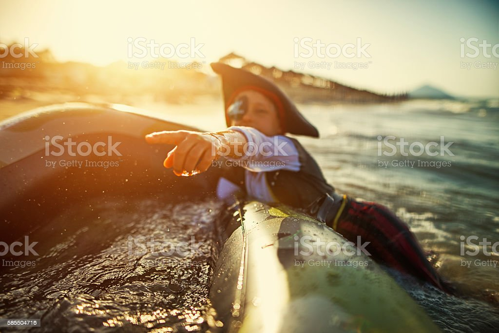 Little boy playing pirate on a sinking boat stock photo