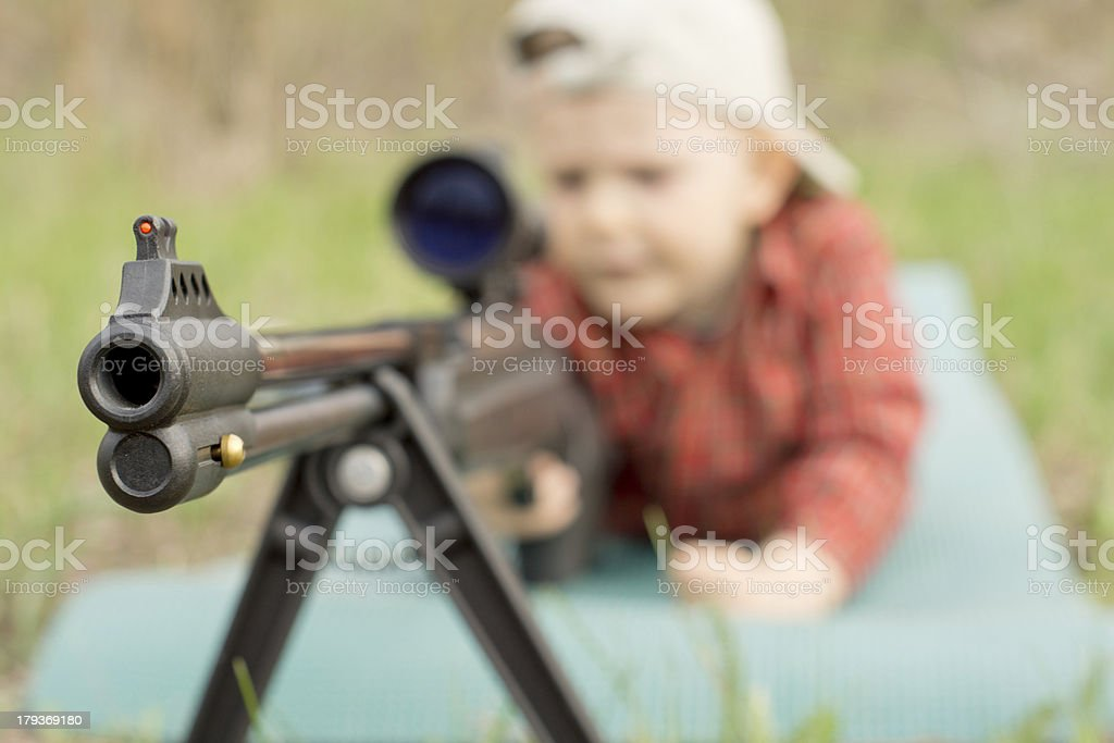 Little boy playing rifle royalty-free stock photo