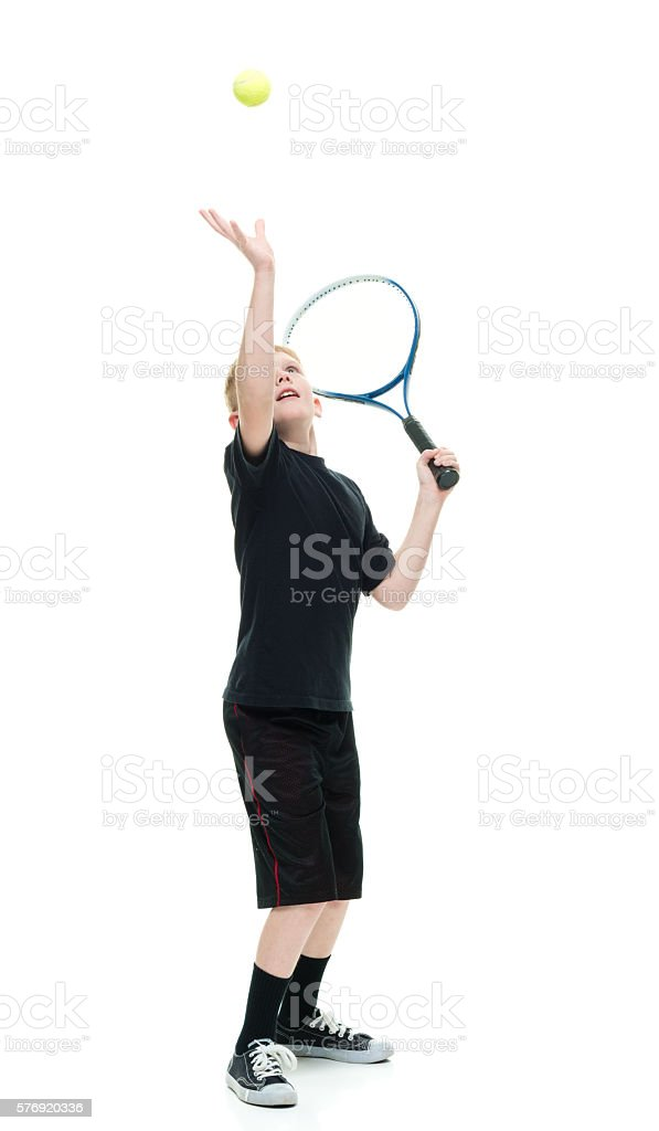 Little boy playing tennis stock photo
