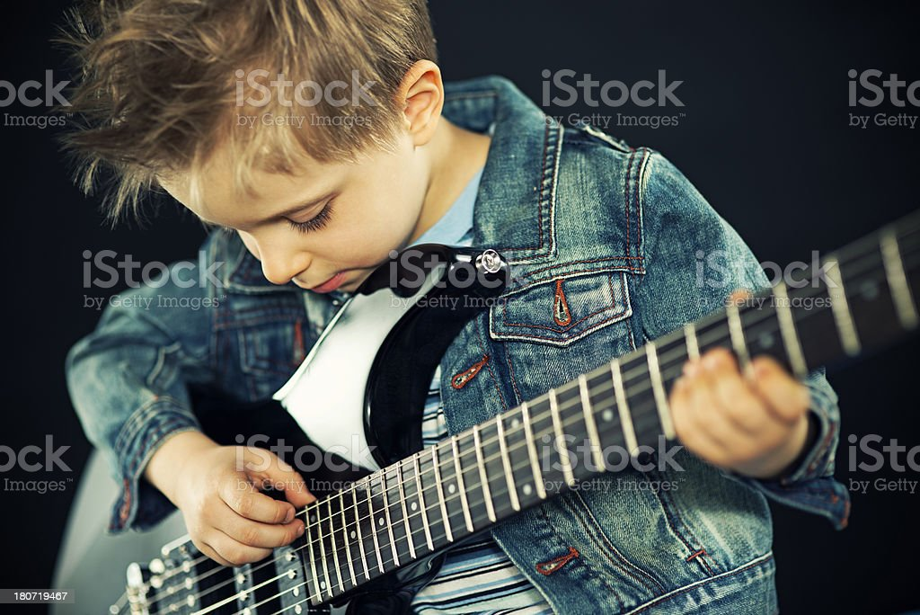 Little boy playing the guitar royalty-free stock photo