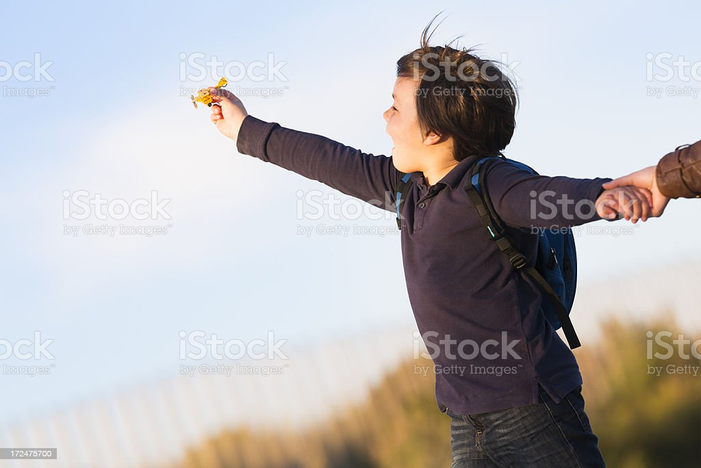 little boy playing with a model airplane royalty-free stock photo
