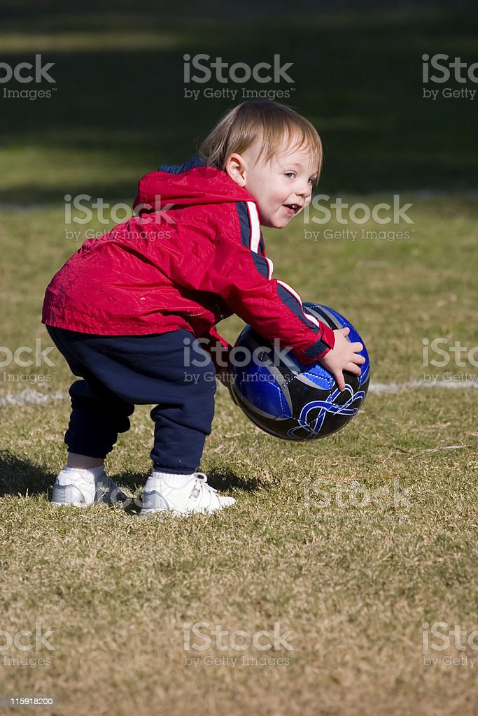 Little Boy Playing With a Soccer Ball royalty-free stock photo