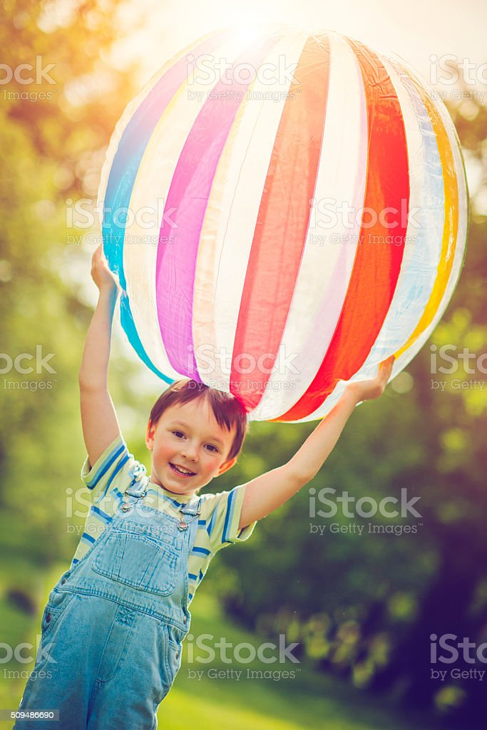 Little boy playing with ball stock photo