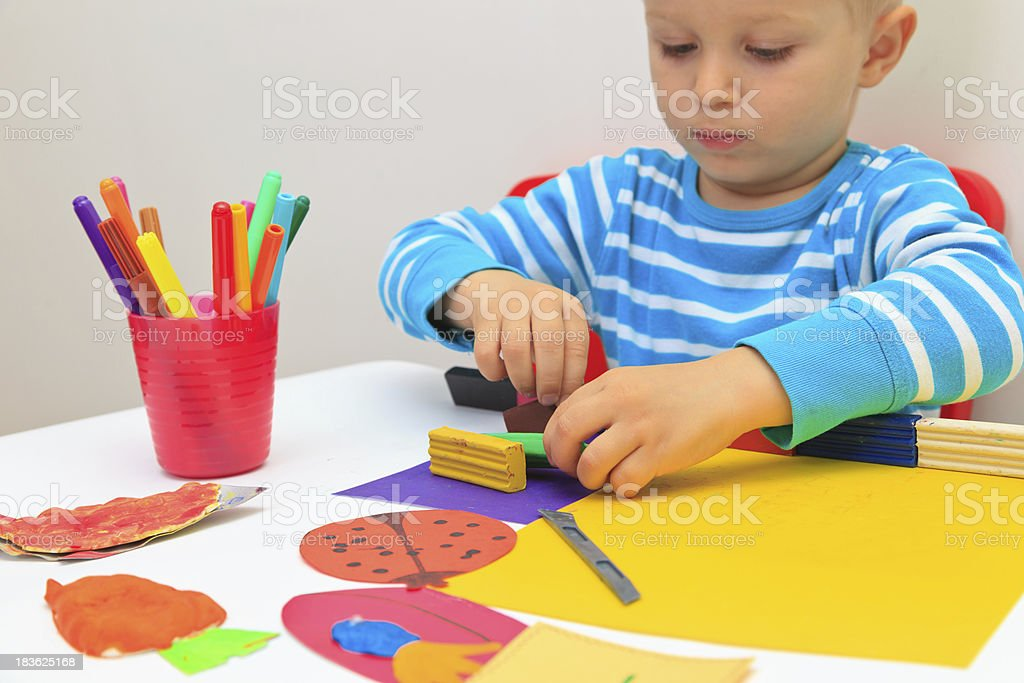 little boy playing with clay dough royalty-free stock photo