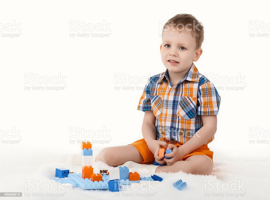 Little boy playing with designer stock photo